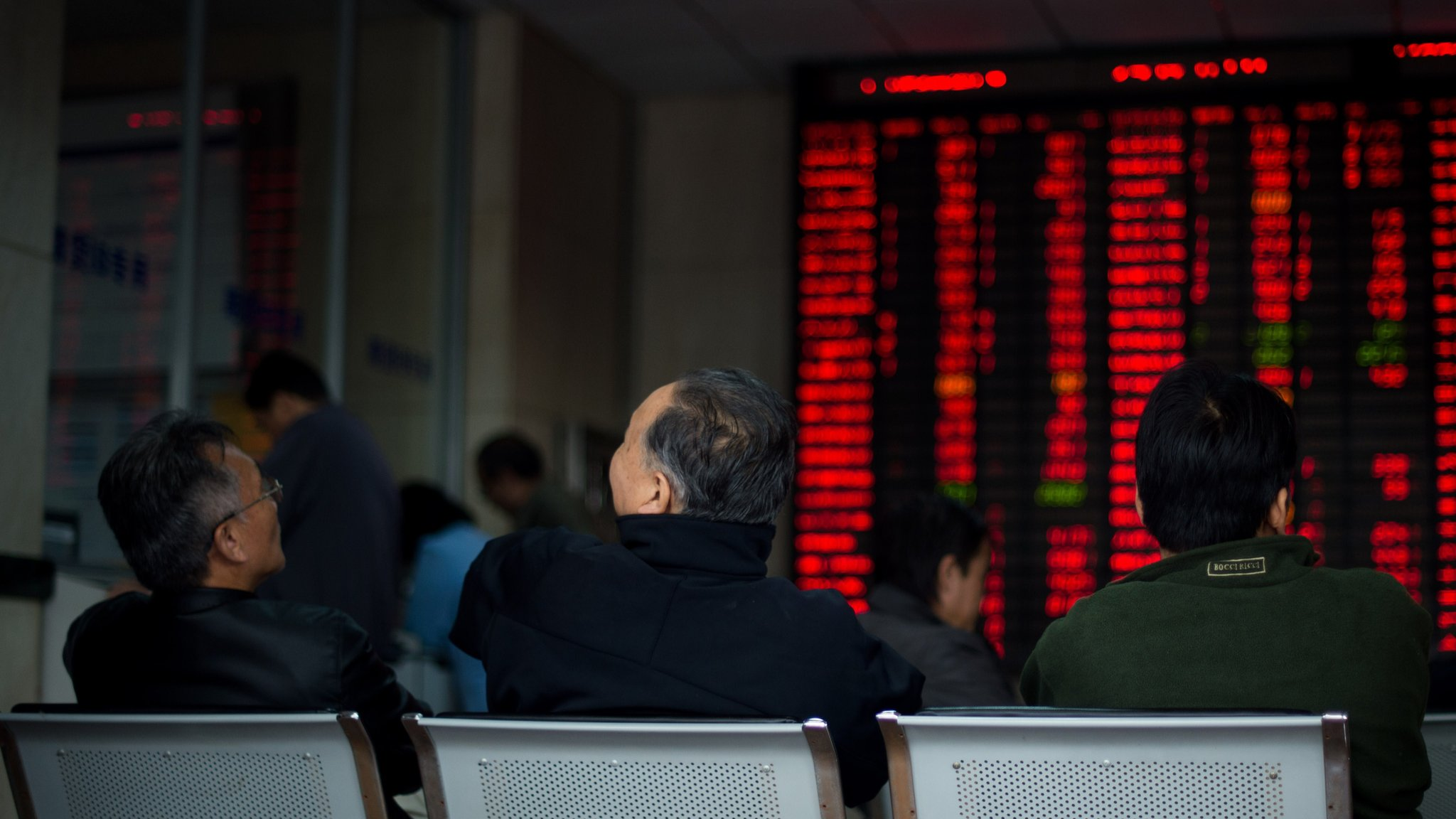 Mainland Chinese shares surge nearly 8% on Monday despite the rest of Asian markets trading lower on Greece's rejection of austerity demands.
