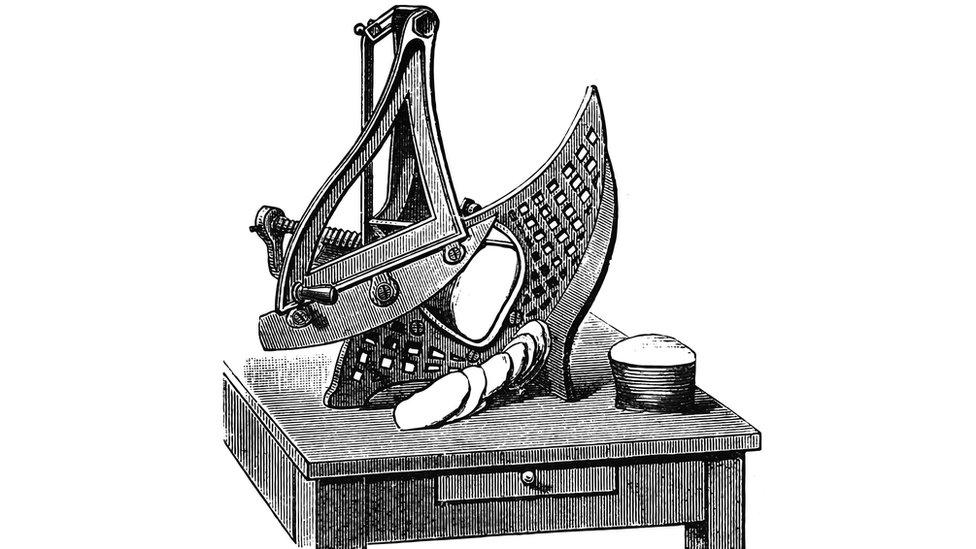 Máquina manual para cortar el pan