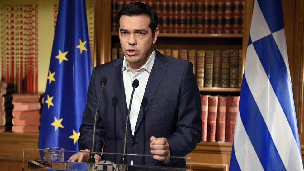 "Greek Prime Minister Alexis Tsipras makes a defiant speech urging a ""No"" vote in Sunday's referendum as bank cash limits begin to bite for Greeks."