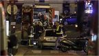 Ambulance workers are seen at the scene in the 10th arrondissement of the French capital Paris, following a string of attacks