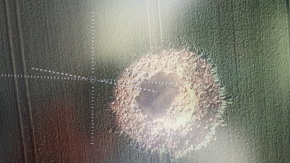 German WW2 bomb leaves giant crater in field