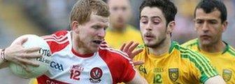 Derry's Enda Lynn is challenged by Ryan McHugh