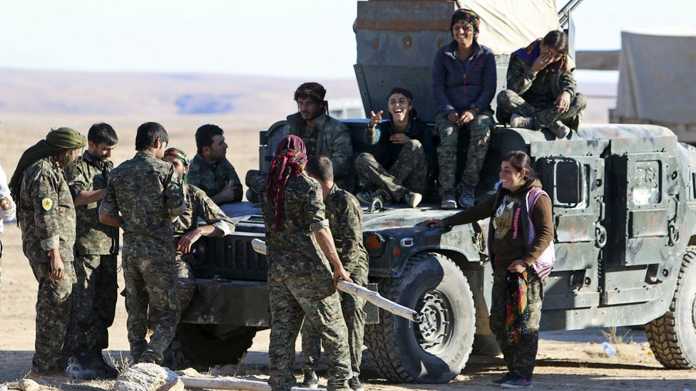 Fighters from the Democratic Forces of Syria gather after taking control of the town of al-Hawl in Hassakeh province, Syria (14 November 2015)