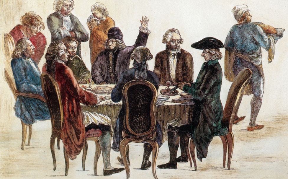 Voltaire llegaría a ser uno de los más destacados representantes de la Ilustración. En esta ilustración, aparece acompañado de otros de ese grupo y es el que tiene la mano levantada.