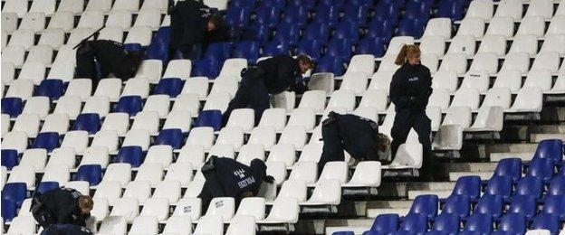 German police officers search between the seats