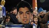 Uruguay fans celebrate with a Luis Suarez mask