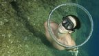 French free diver Guillaume Nery blows a bubble ring