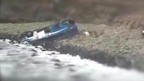 Peru bus plunges from cliff on to beach