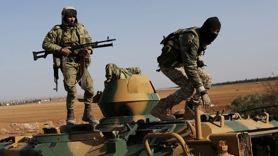 صورة لأفراد من مسلحي المعارضة