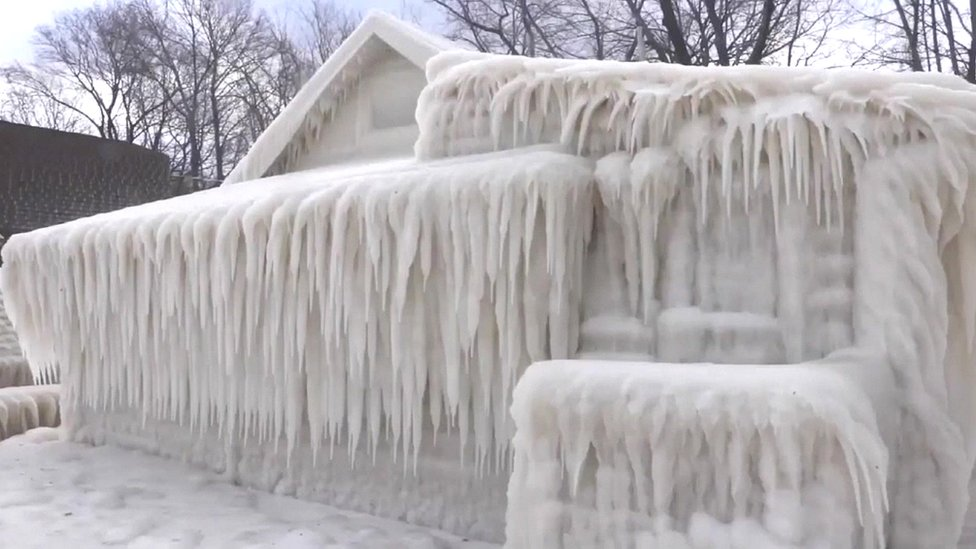 House in New York state encased in ice during cold spell