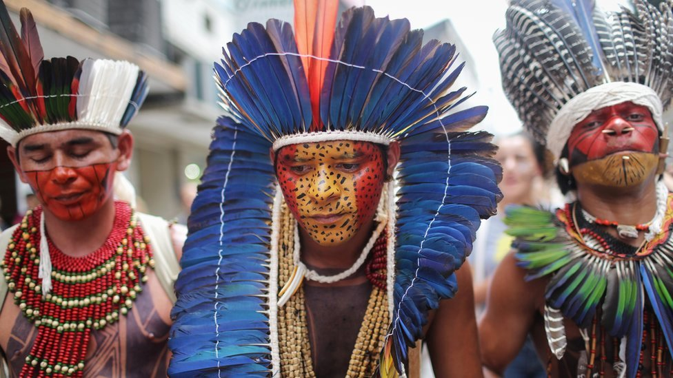 Members of indigenous groups in the state of Rio de Janeiro march in November 2015 against a planned constitutional amendment which would allow Congress to demarcate indigenous territory.