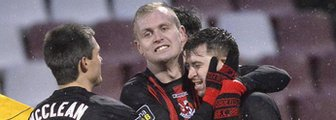 Crusaders players celebrate victory over Ballymena United at Seaview