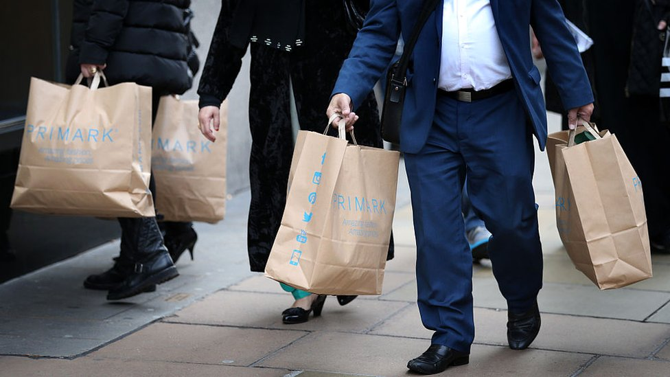 Customers leave Primark's flagship store on Oxford Street, London