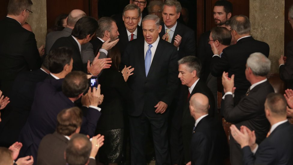 Israeli Prime Minister Benjamin Netanyahu (C) is greeted by members of Congress as he arrives to speak during a joint meeting of the United States Congress in the House chamber at the U.S. Capitol March 3, 2015 in Washington, DC