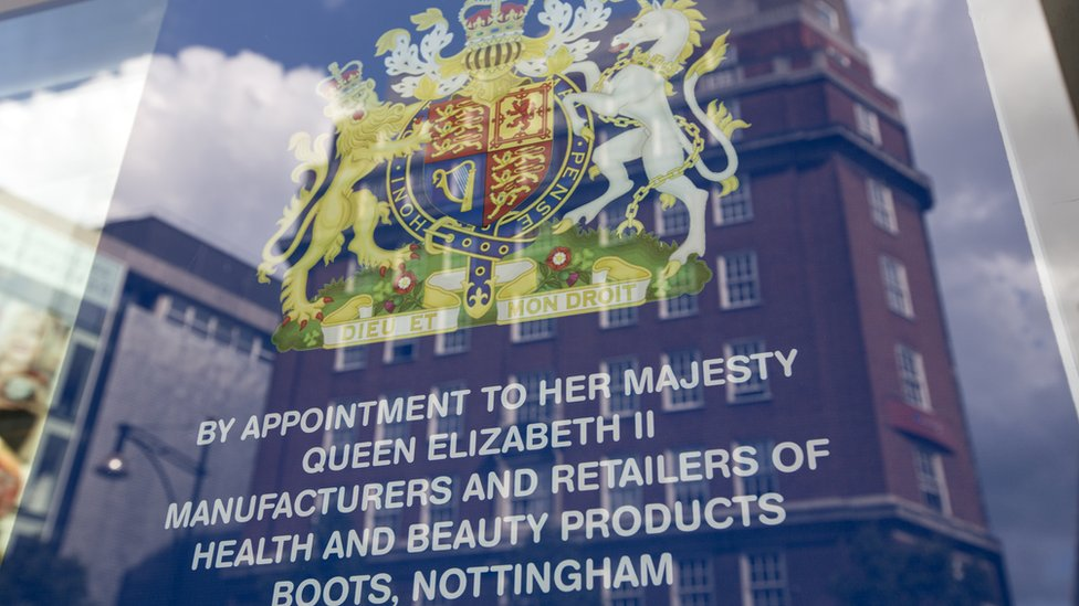 The royal warrant for chemist Boots is displayed in the window of their Oxford Street branch
