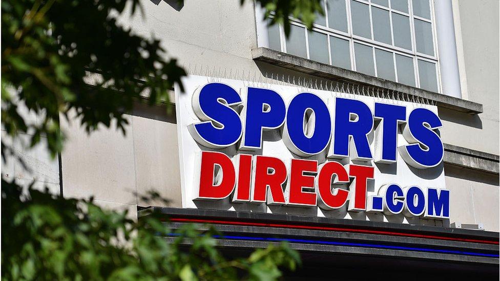 Sports Direct chairman lambasts critics as profits fall
