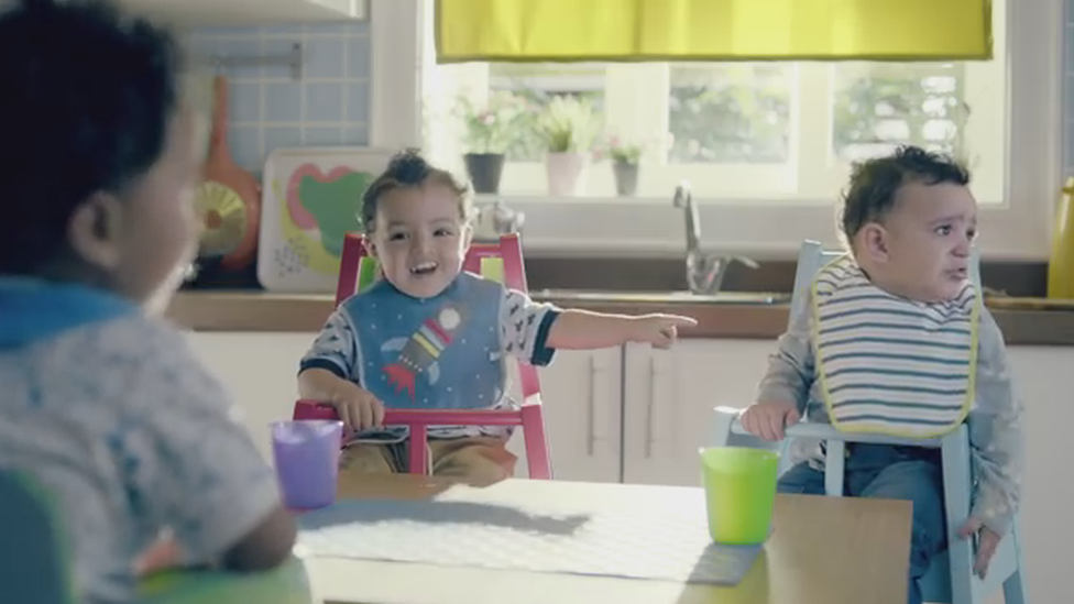 A grab from the advert showing one toddler teasing another toddler