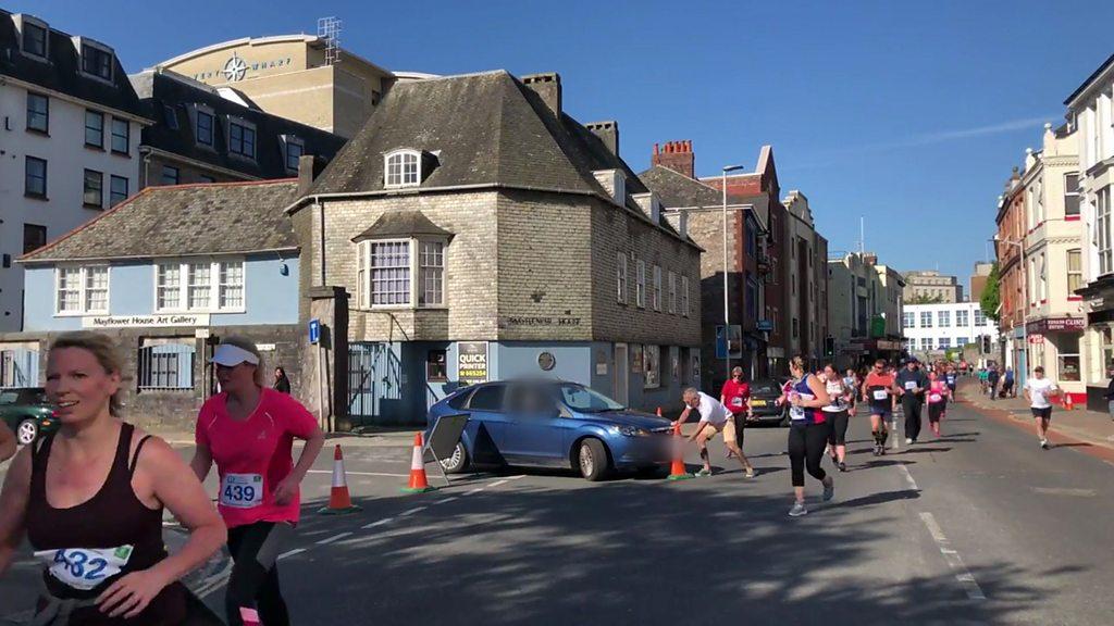 Woman drives car through half marathon in Plymouth