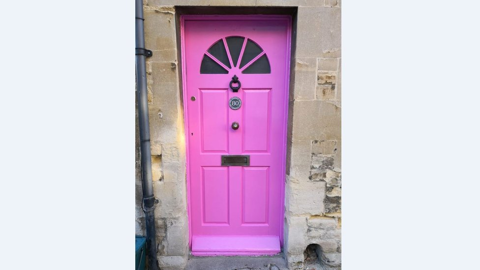 Cirencester home owner told to change bright pink door