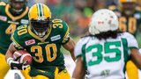John White of the Edmonton Eskimos runs with the ball