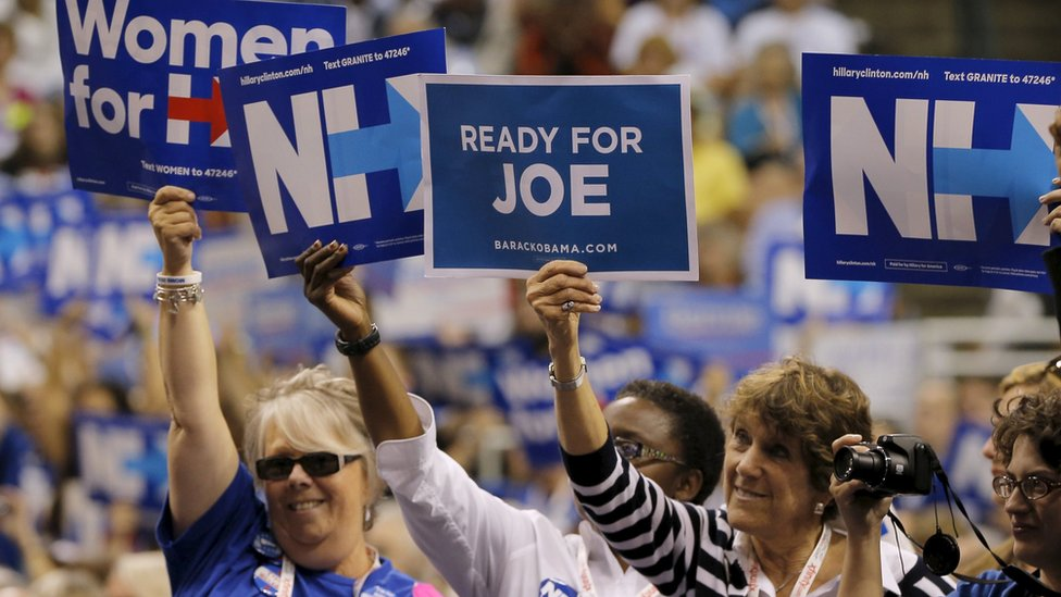 "A woman holds up a sign reading ""Ready for Joe,"" referring to U.S. Vice President Joe Biden, while U.S. Democratic presidential candidate Hillary Clinton speaks at the New Hampshire Democratic Party State Convention in Manchester, New Hampshire September 19, 2015"