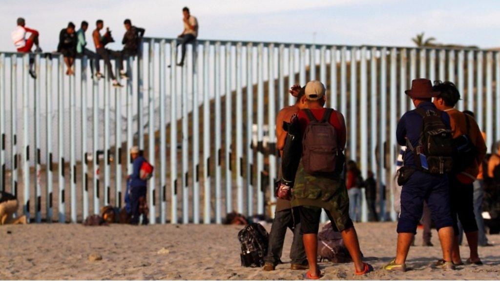 Caravan migrants reach United States border