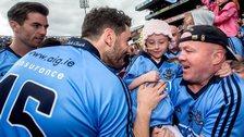Dublin stars Michael Darragh Macauley and Bernard Brogan greet a young fan after the Leinster Final earlier this month
