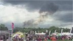 Smoke rising into the sky above CarFest