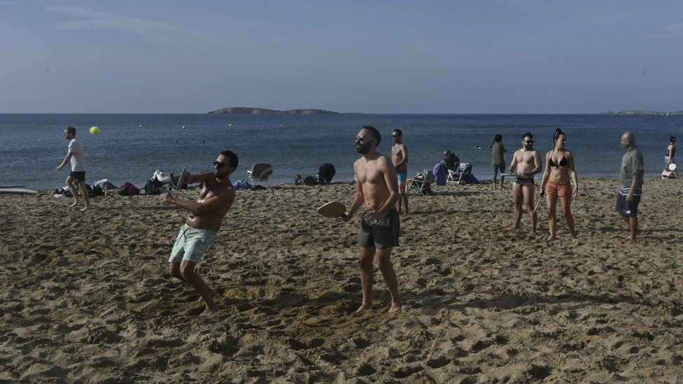 People play at a beach near Athens