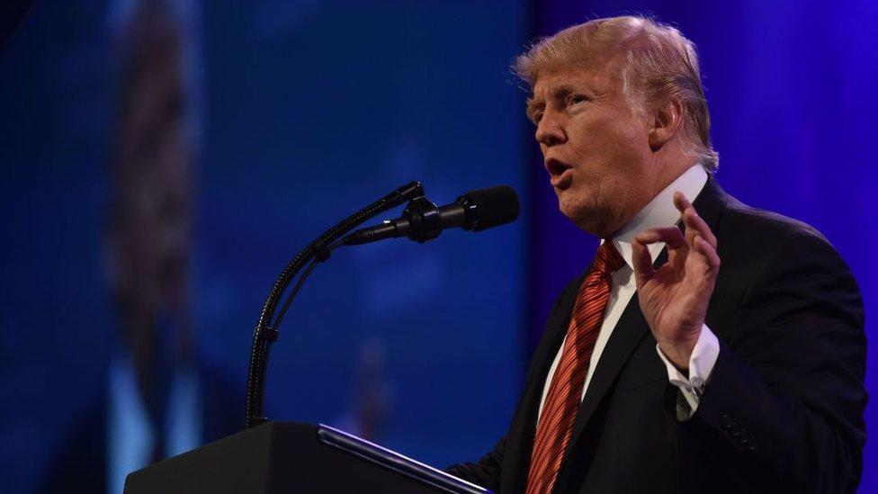 Donald Trump softens tone to urge 'a new unity'
