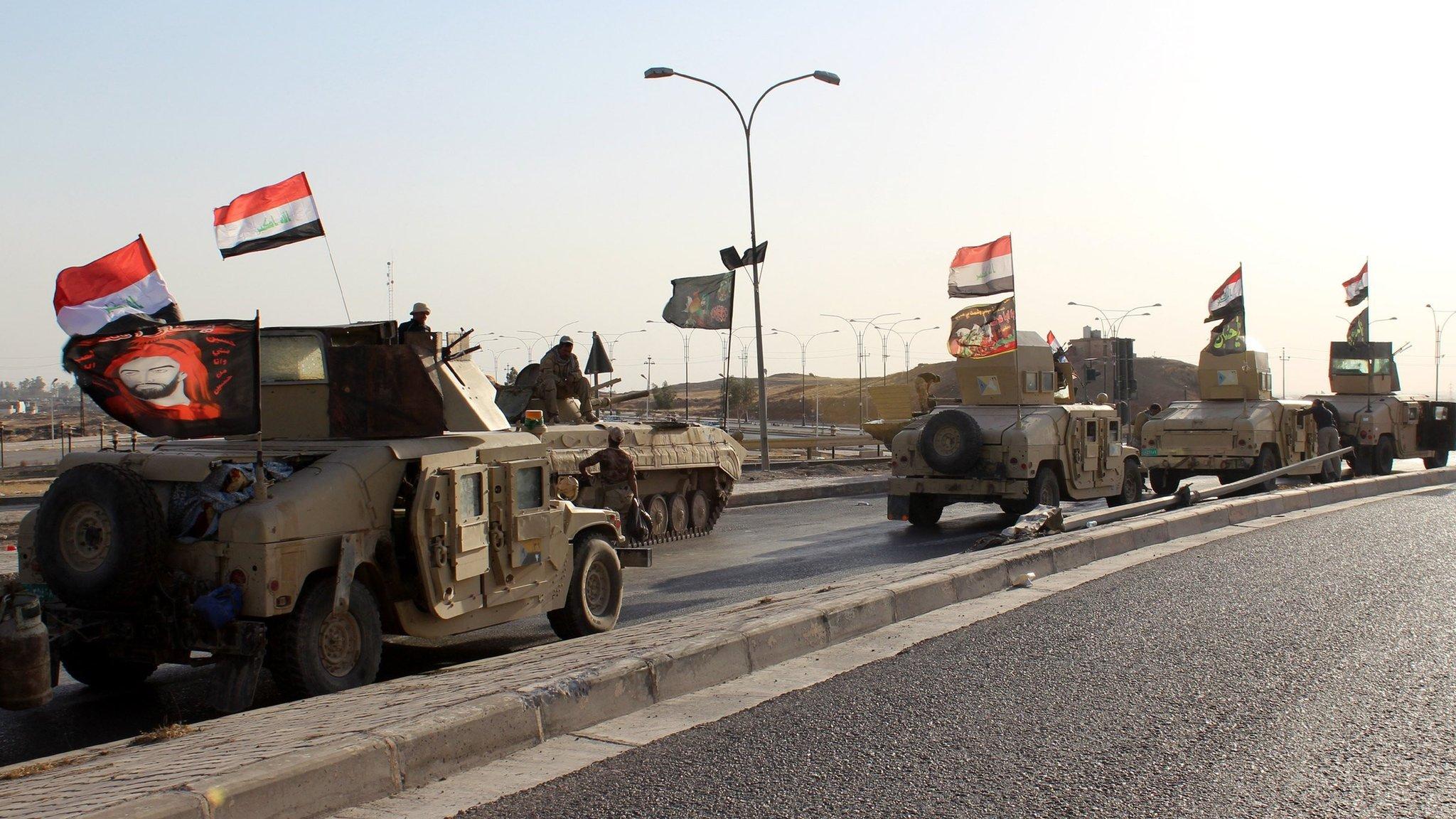 Kirkuk: Iraqi forces seize largest oilfields near city