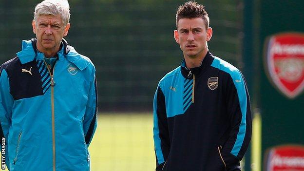 Arsenal manager Arsene Wenger and defender Laurent Koscielny in training