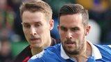 Glentoran's Jonny Addis in action against Linfield striker Andrew Waterworth