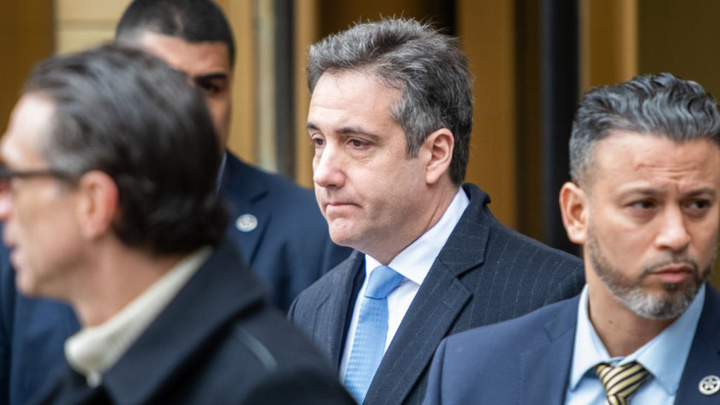 Michael Cohen blames Trump's 'dirty deeds' as he is jailed