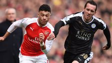 Christian Fuchs in action with Arsenal's Alex Oxlade Chamberlain