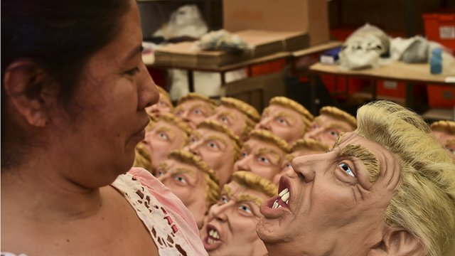 Mexican woman inspects Trump mask