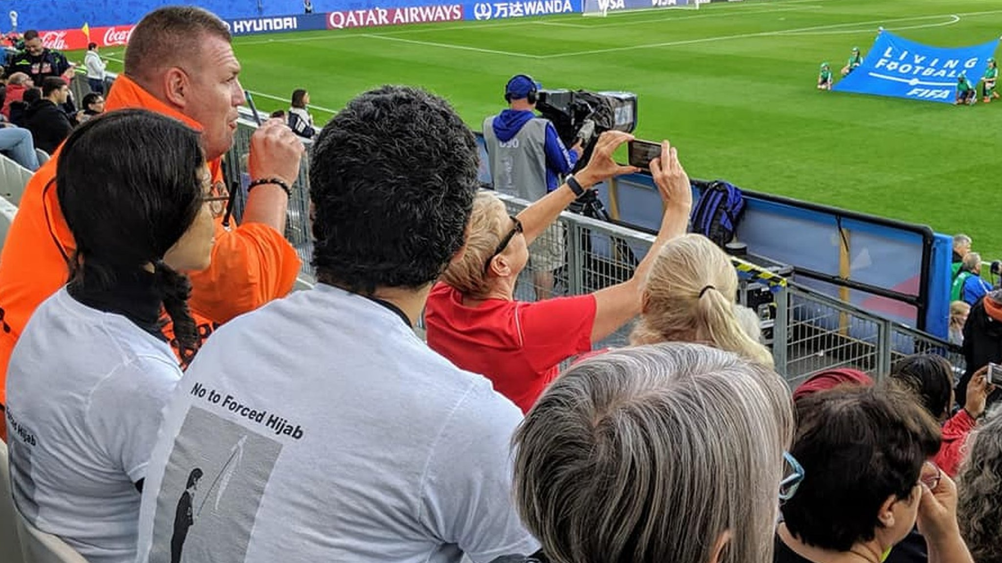 Women's World Cup: Fifa says it was wrong to remove fans for wearing Iran slogan T-shirts