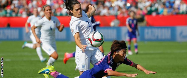 Claire Rafferty of England fouls Saori Ariyoshi of Japan to concede a penalty