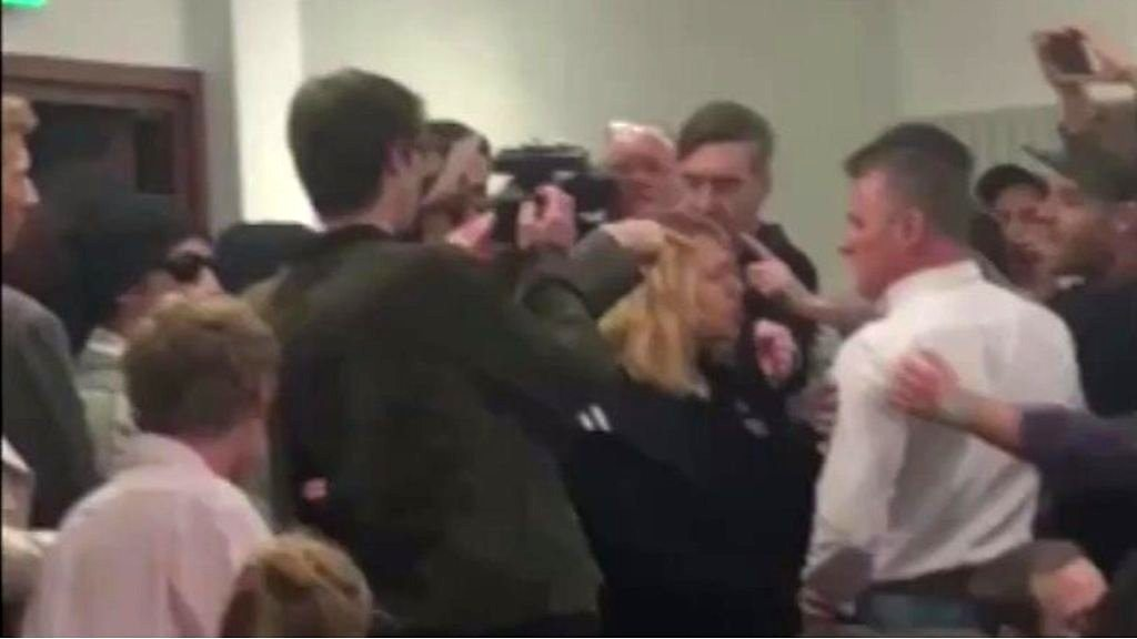 Protesters disrupt a speech by MP Jacob Rees-Mogg