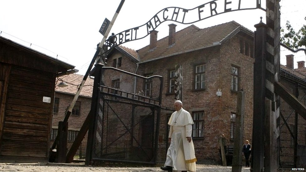 Pope Francis makes a solitary walk into Auschwitz camp