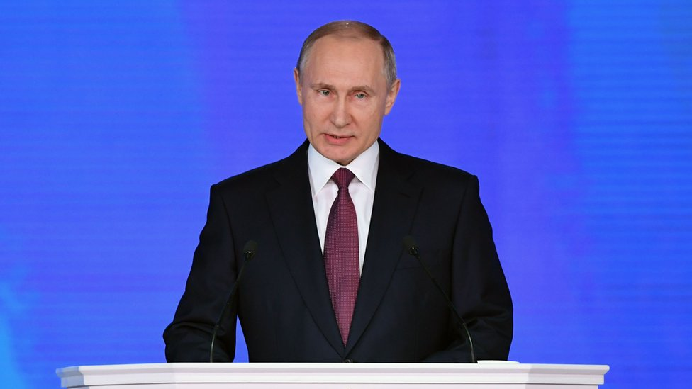 Russian President Vladimir Putin addresses the Federal Assembly at Moscow's Manezh exhibition centre on 1 March 2018