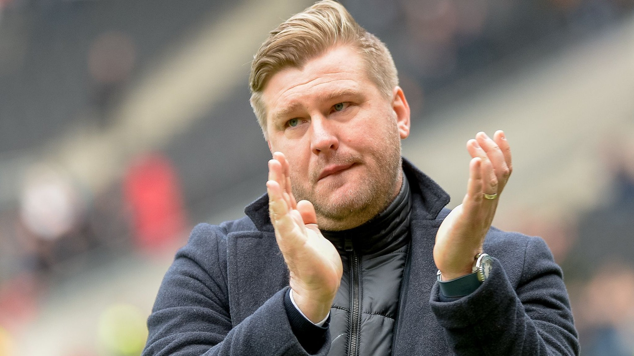 How do MK Dons move forward after Robinson's departure?