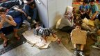 Migrants rest in an underground passage near to Keleti train starion in Budapest, Hungary