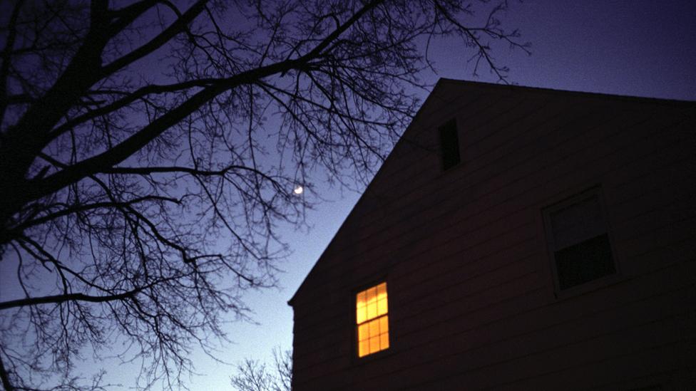 Single lighted window at night