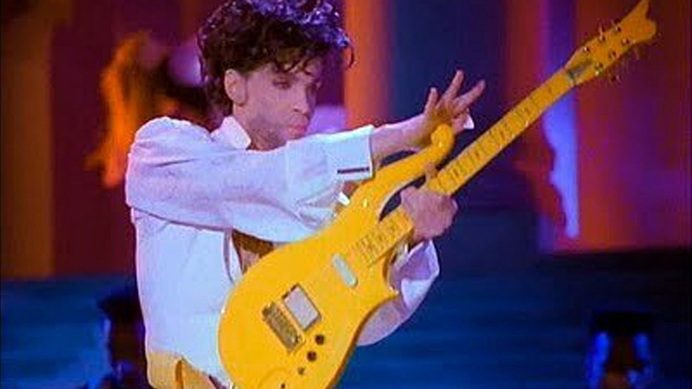 Prince's guitar and a lock of Bowie's hair fetch $150,000 at US auction