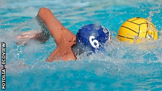 Young man playing water polo