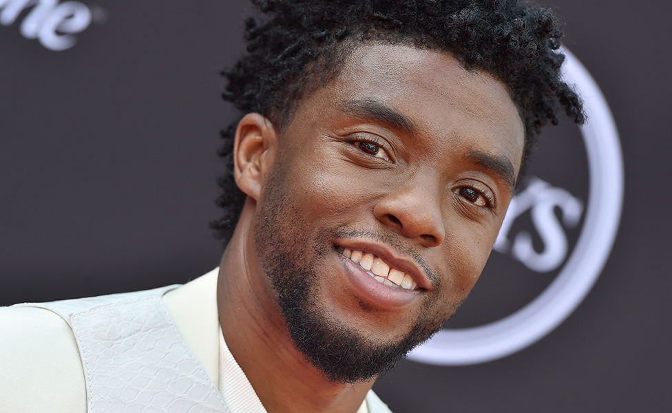Chadwick Boseman looking at camera