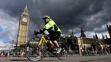 A cyclist rides past Big Ben