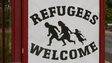 Poster reading 'refugees welcome'