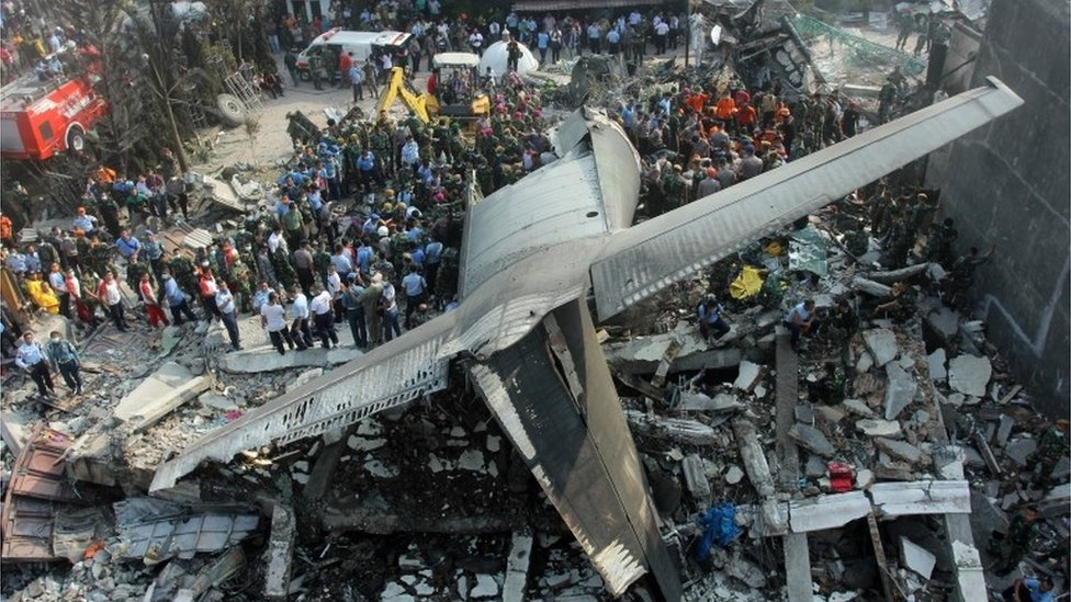 Indonesian officials say 122 people were on board a military plane which crashed into houses in Medan on Tuesday, with no known survivors.